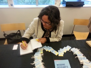 Lisa signing copies of her book. Photo copyright: Lisa Francesca